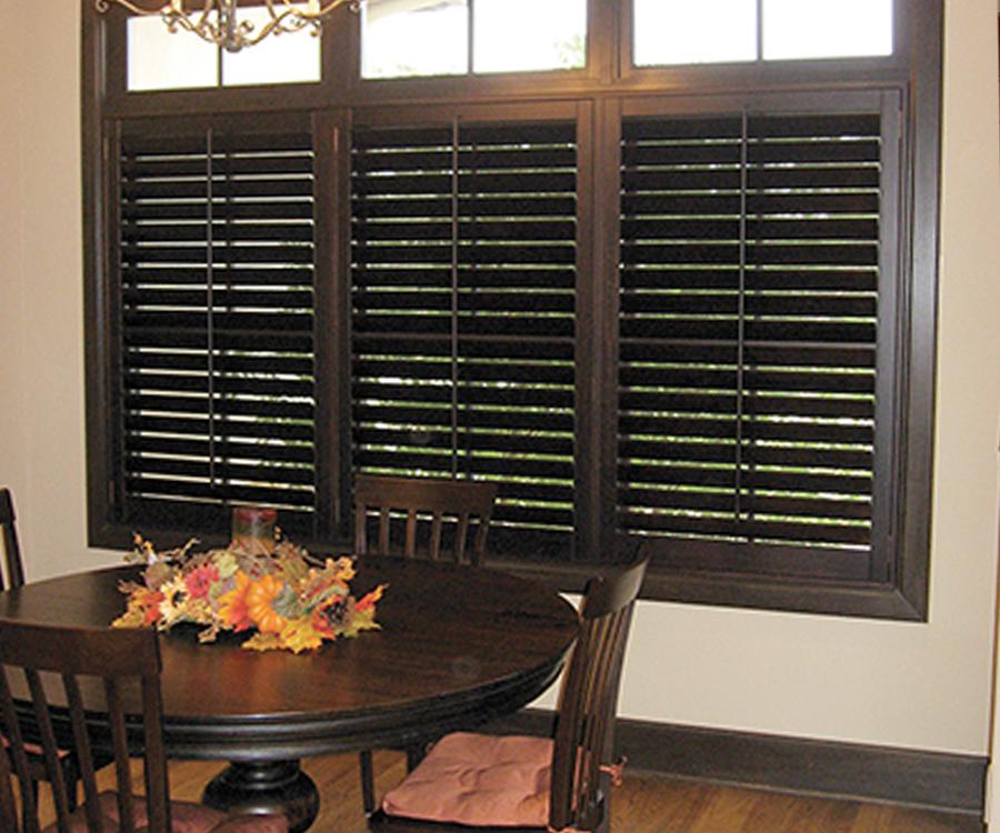 black shutters with tilt rods Hunter Douglas Austin 78758