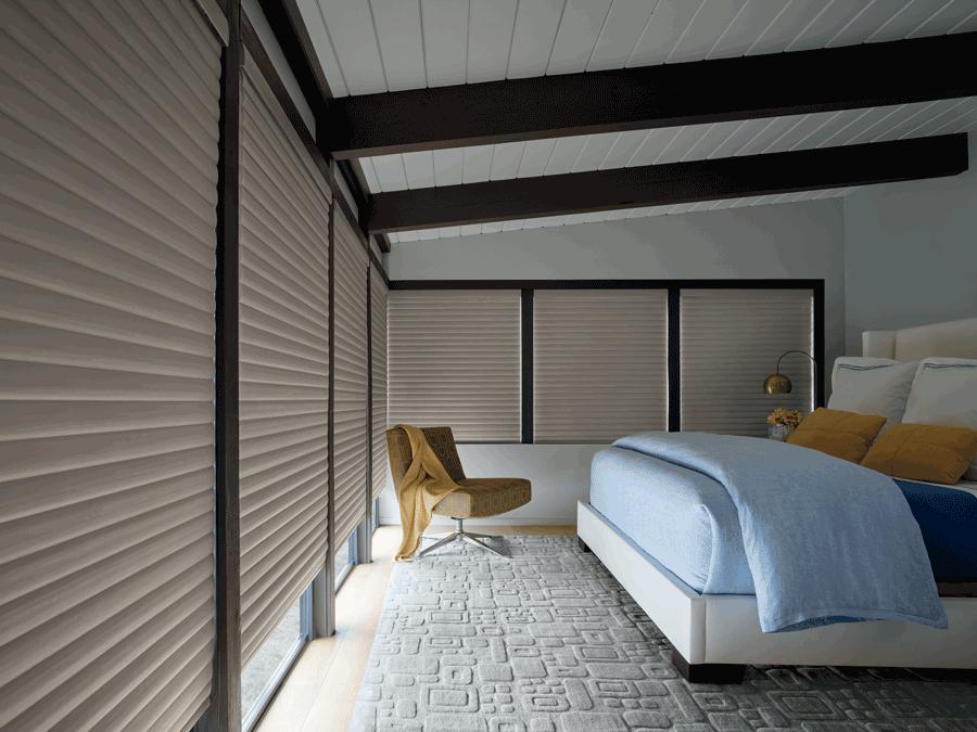 contemporary bedroom with room darkening motorized shades Austin TX