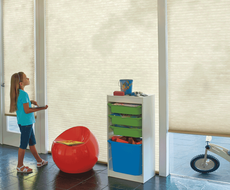 Motorized shades in this Austin, Texas home are great for child safety.