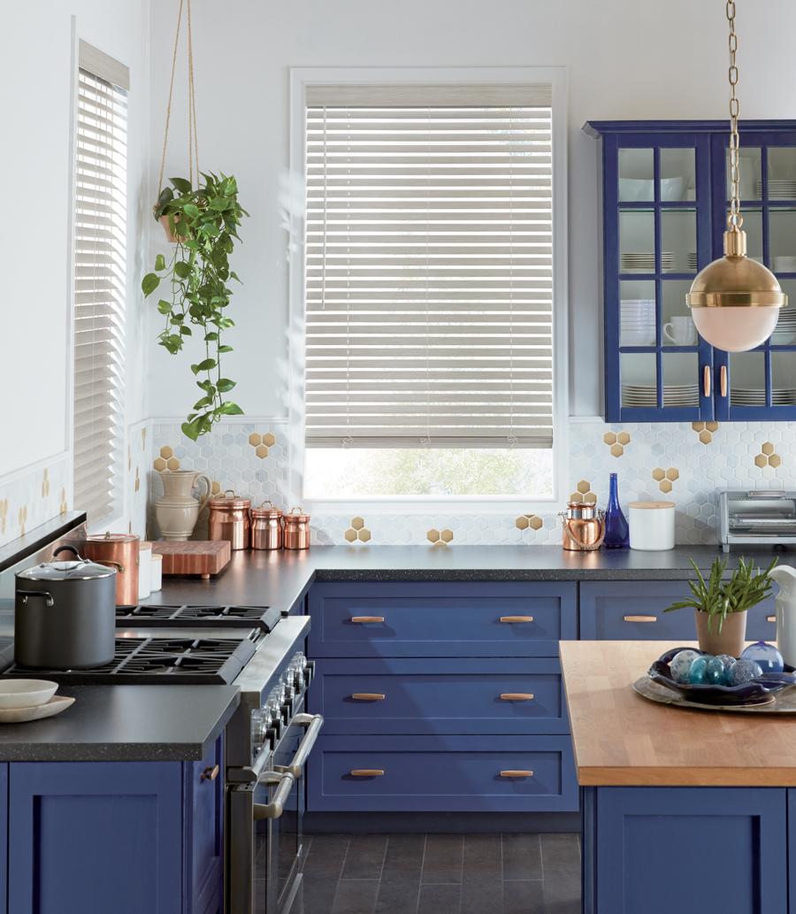 hunter douglas white faux wood blinds in blue kitchen Austin TX