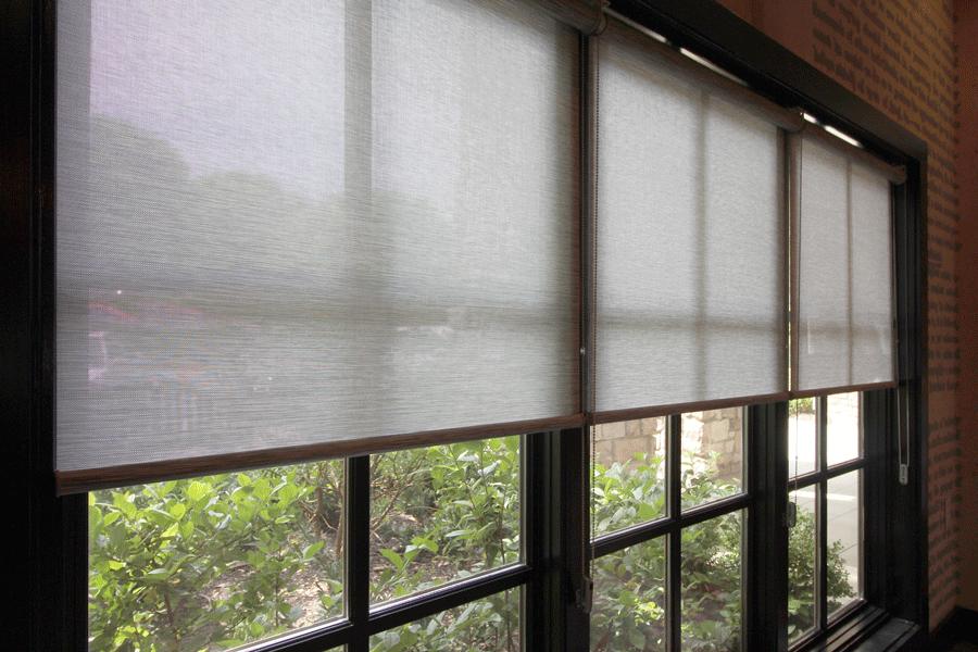 black window frames with gray roller shades Austin TX