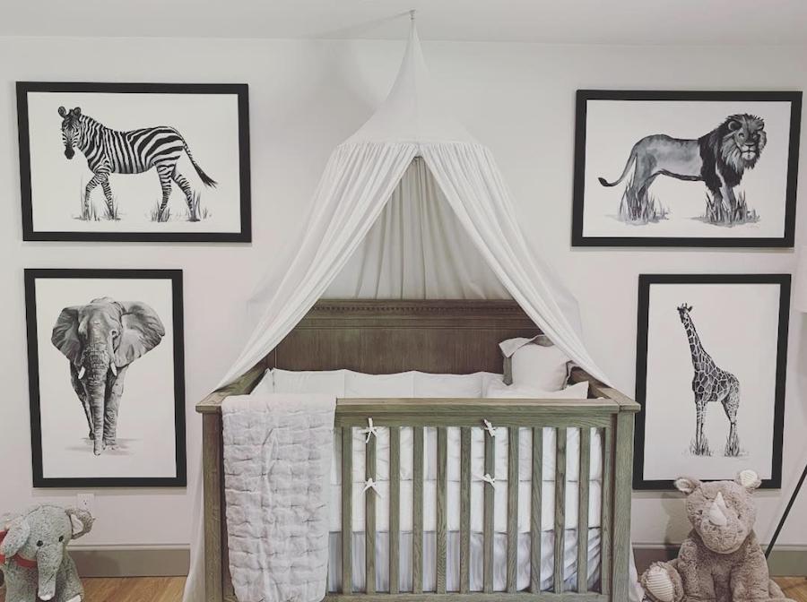 nursery with safari animal prints framed in the color black