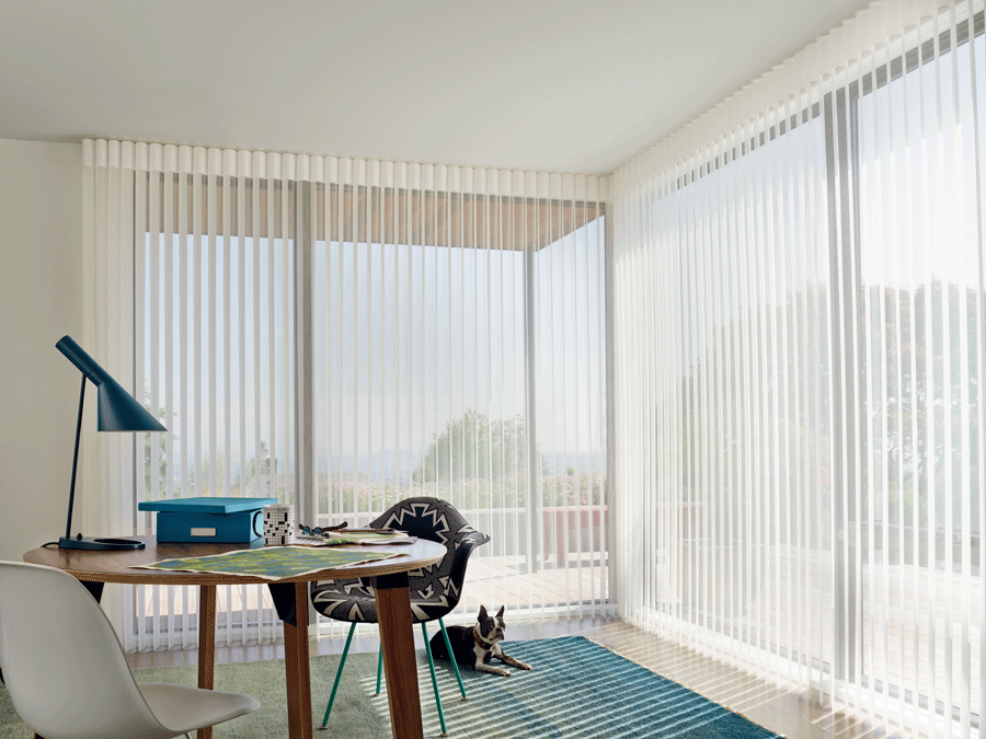 Bring in the perfect amount of light into your home office with luminette view through sheer vertical shades.