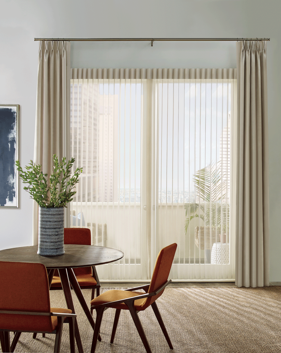 Sliding doors with luminette privacy sheers and side drapery panels.