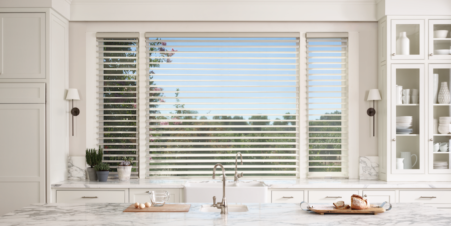 Nature-inspired kitchen design with sheer Hunter Douglas shades over the sink window