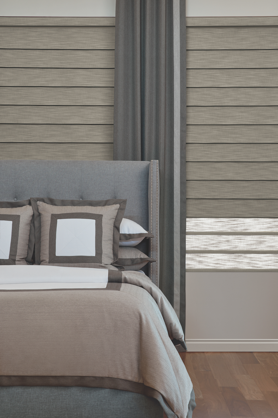 Vignette Roman Shades by Hunter Douglas in bedroom.