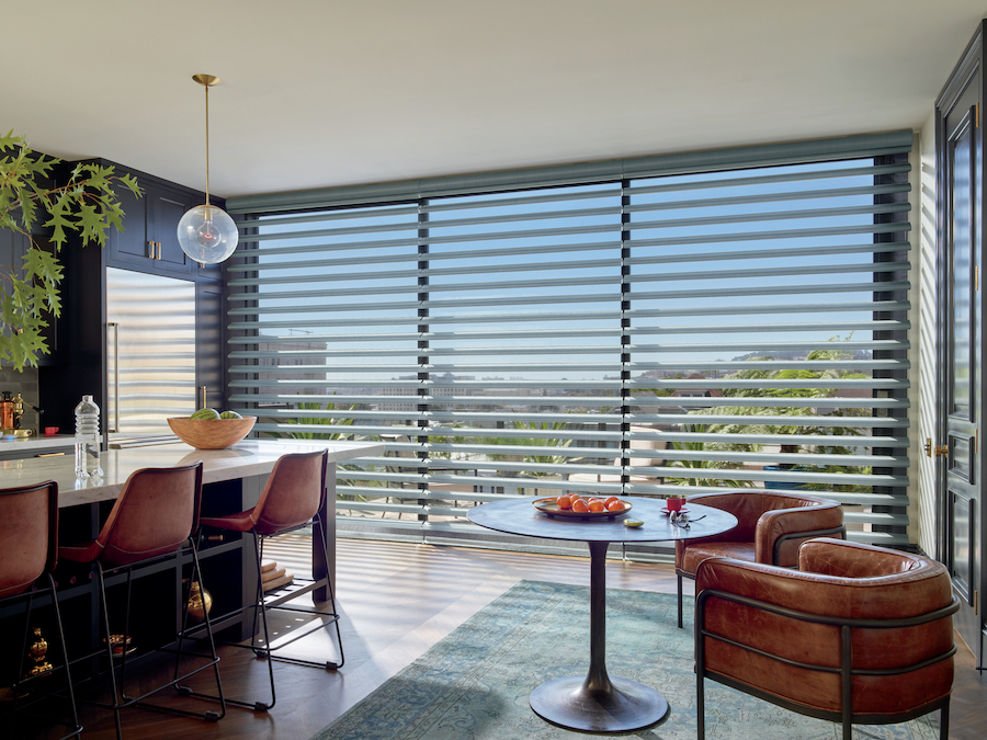 open concept living space Multiple Pirouette® window shades can cross a wall of windows seamlessly