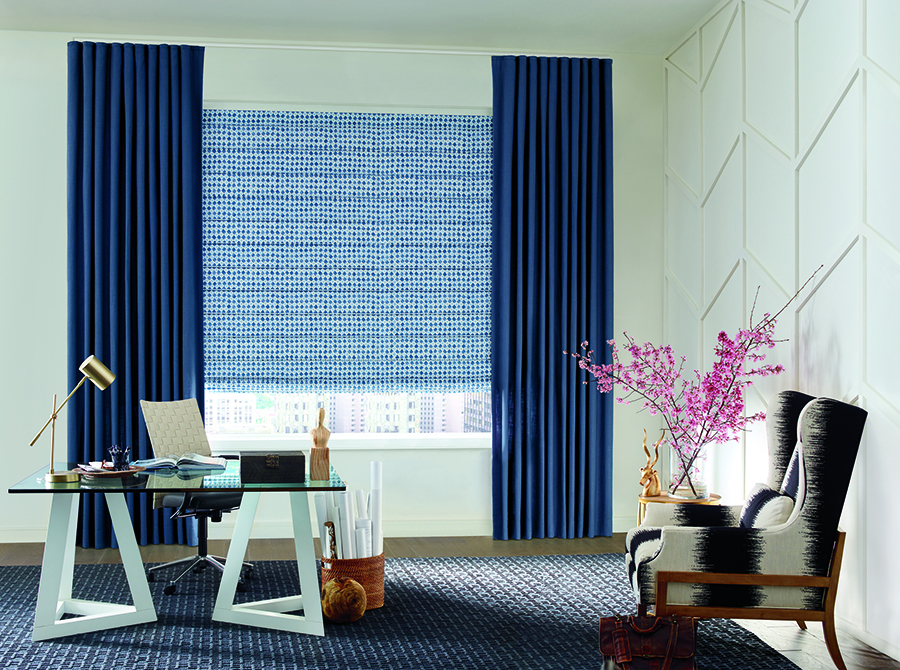 Blue shades with dark blue drapes in home office.