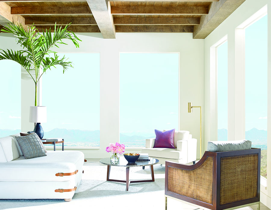 living room space with no window coverings energy saving shades