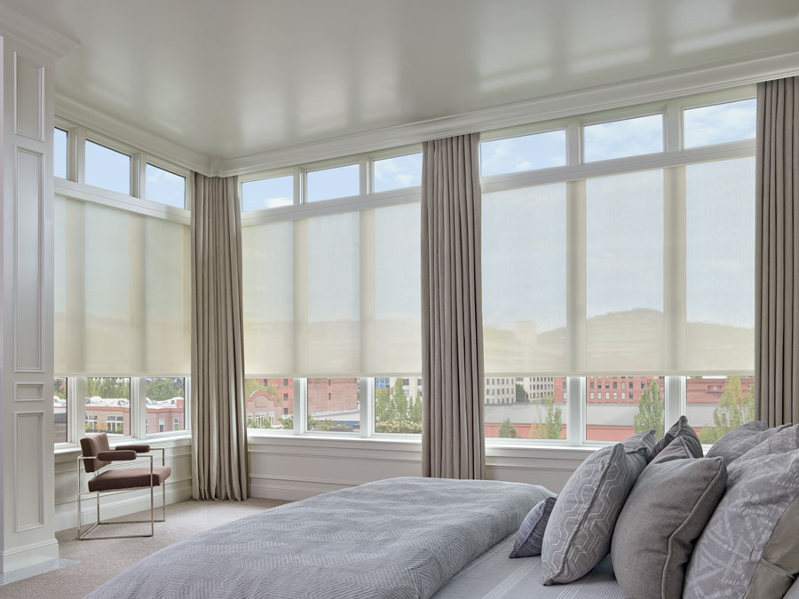 Austin TX home largest windows covered with roller shades and draperies