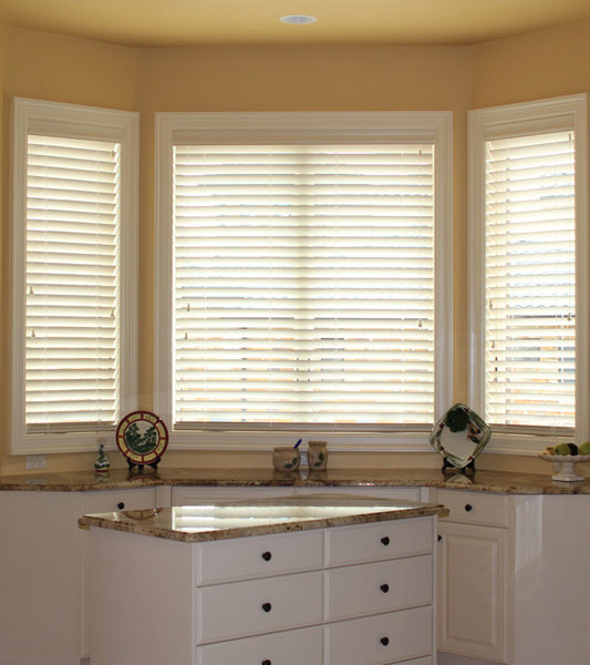kitchen white wood blinds bump out window blinds Austin TX