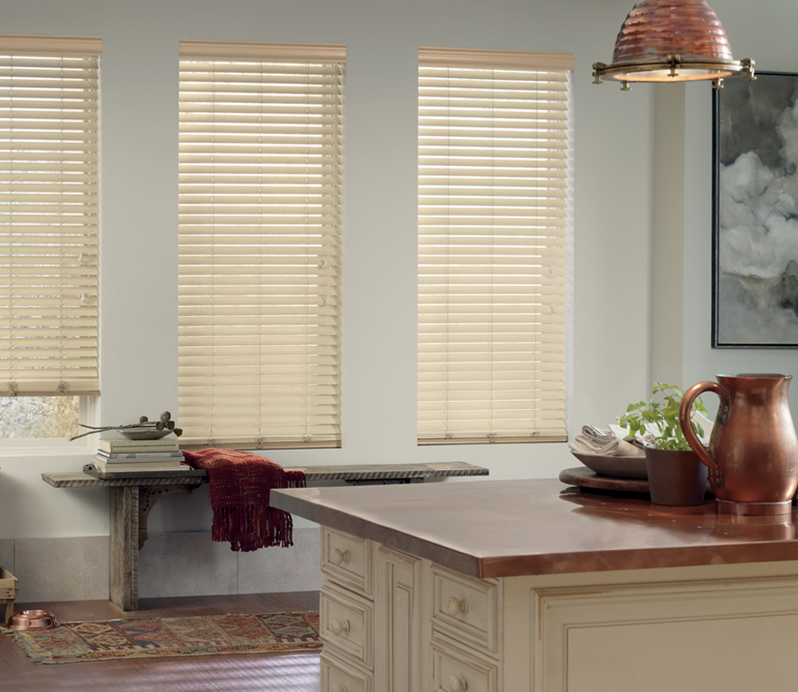 natural color faux wood blinds three windows in kitchen with copper accents Austin TX