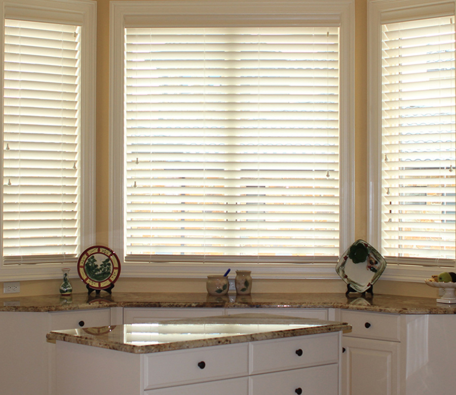bay window above kitchen counter with traditional window blinds Austin TX