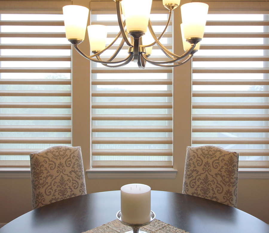 dining room triple windows with pirouette shades Austin TX