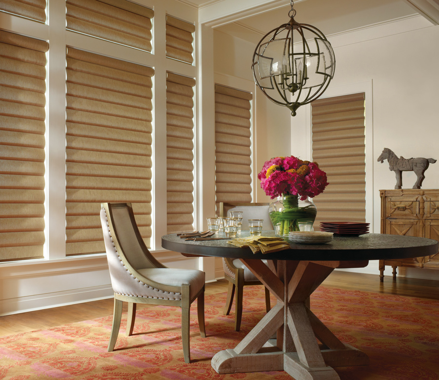 dining room with gold fabric pirouette shades Austin TX