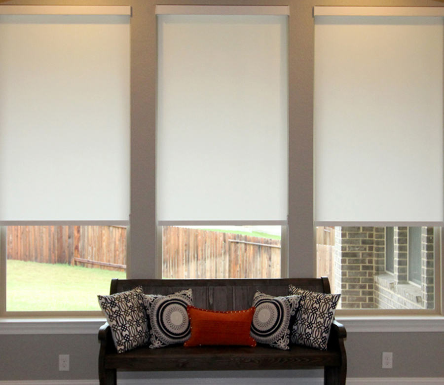 triple window in Austin TX living room with hunter douglas roller shades