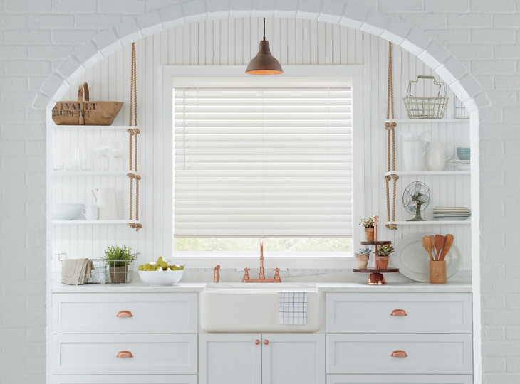 white kitchen with copper hardware white wood blinds Austin TX