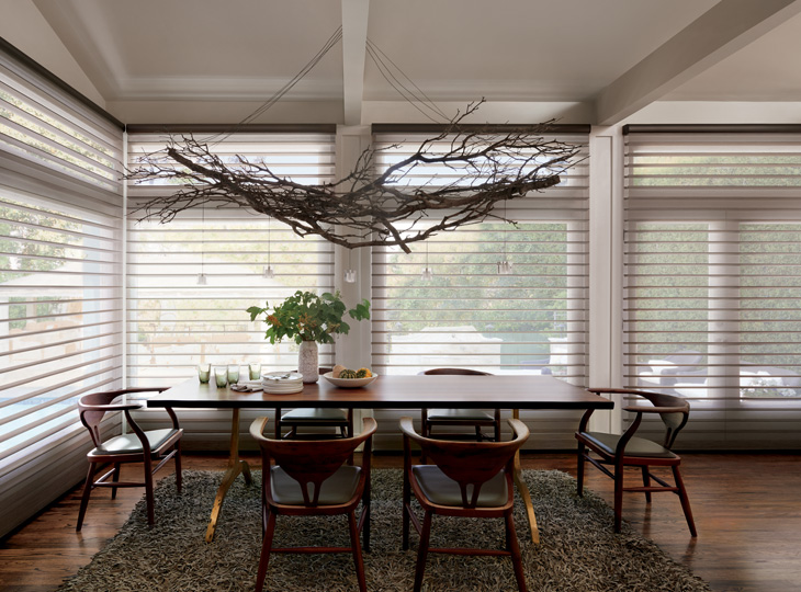 dining room with floor to ceiling window silhouette shades Austin TX