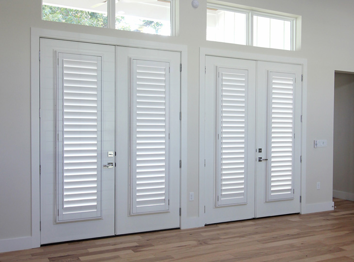 double sets of white french doors with custom shutters fro french doors Austin TX