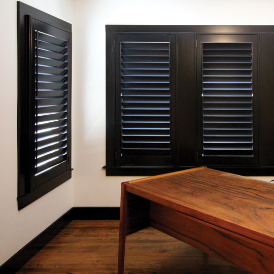 interior window shutters dark wood hinged panel plantation shutters Austin 78731