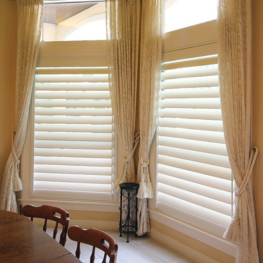 interior shutters on dining room window with side draperies Austin TX