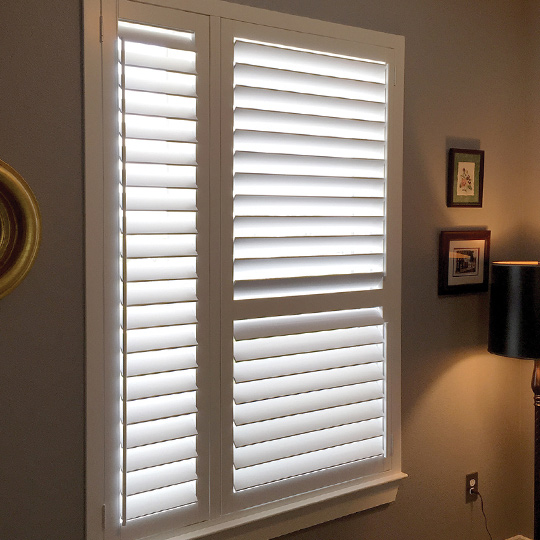 custom hardwood shutters on bedroom window in Austin TX