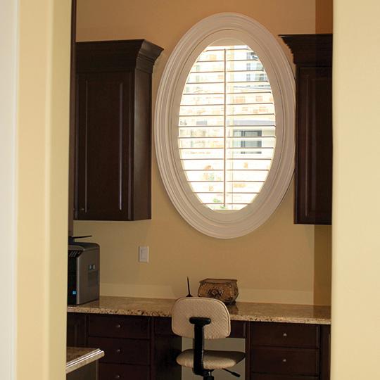 oval shaped shutters on oval window in home office in Austin TX
