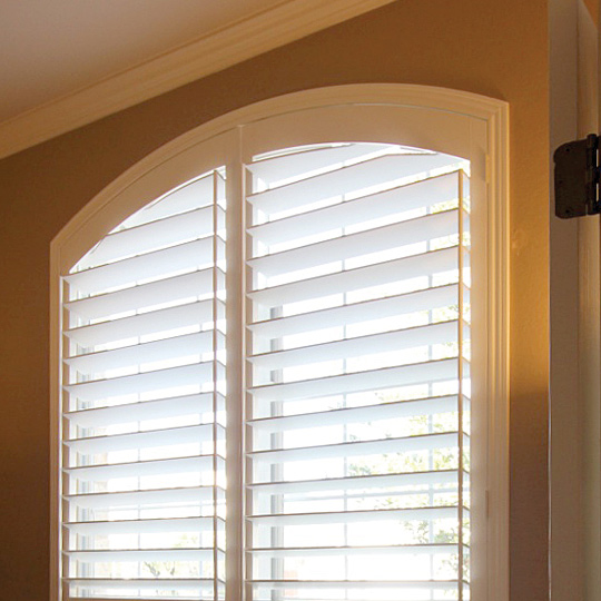 side tilt shutters on arched windows in Austin TX home