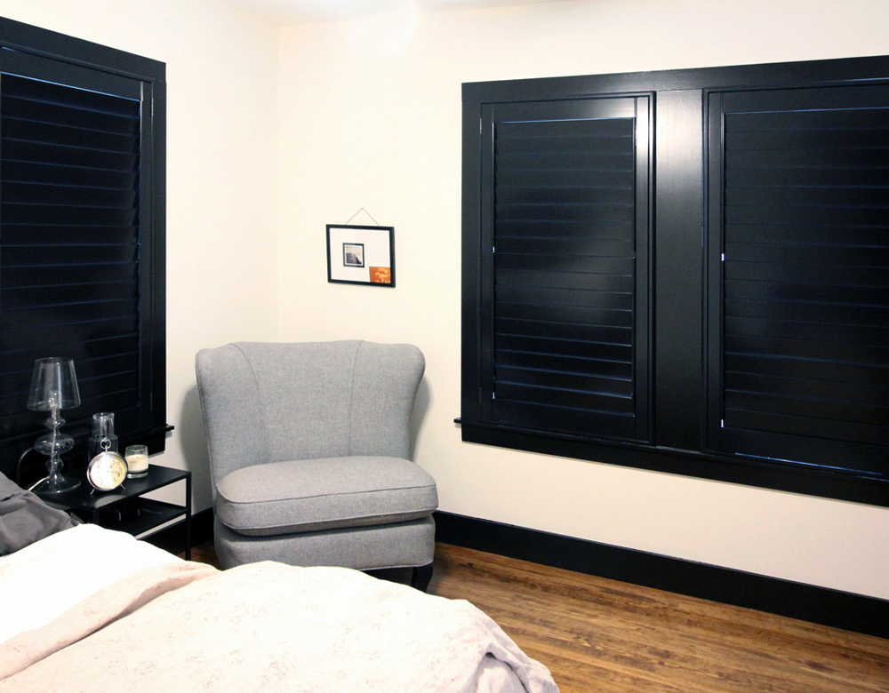 bedroom black plantation shutters recent work done by Austin Window Fashions 78758