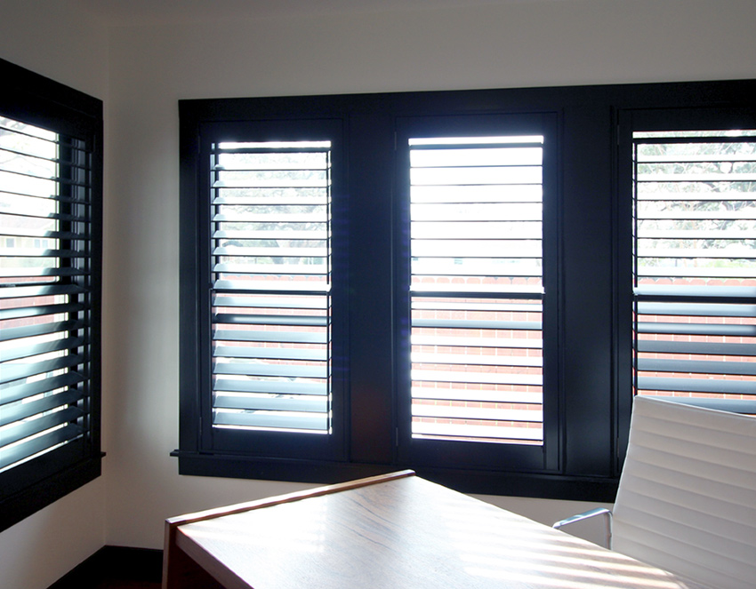 home office black plantation shutters recent work done by Austin Window Fashions 78758