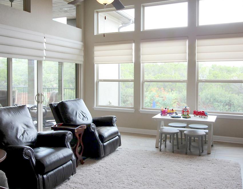 living room vignette modern roman shades recent work done by Austin Window Fashions 78758