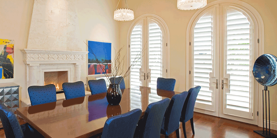 Dining room showing benefits of plantation shutters on doors.