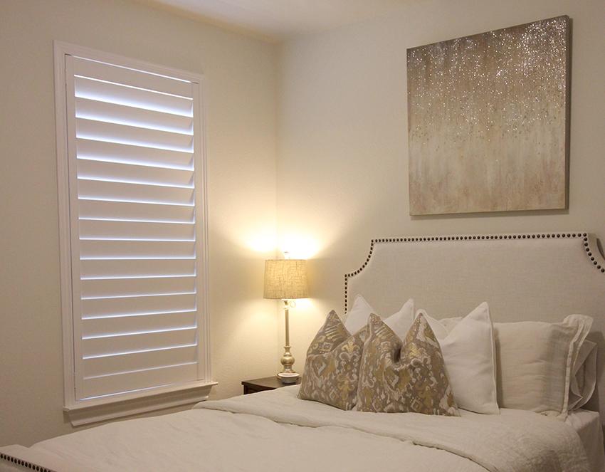 master bedroom white plantation shutters closed Leander 78641