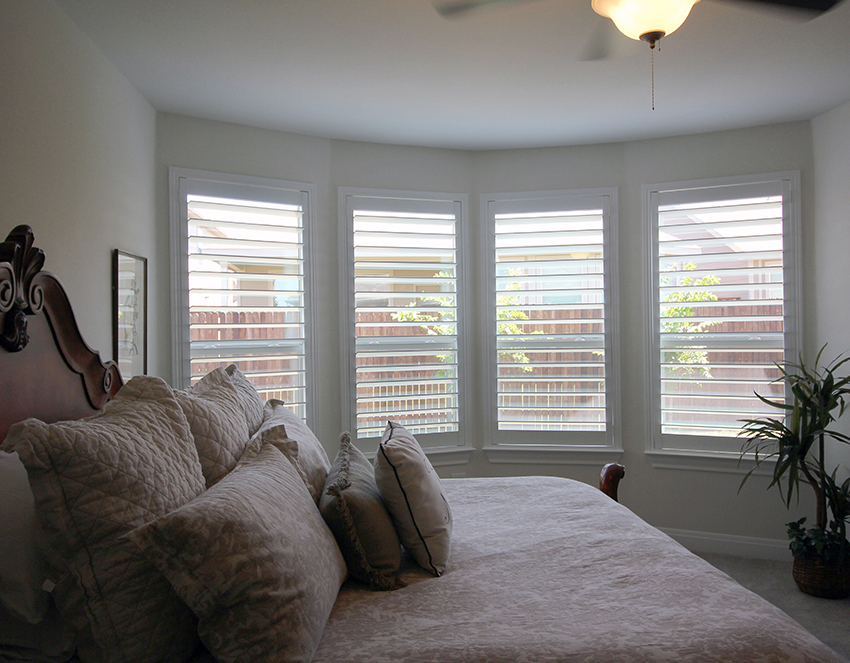 master bedroom with white open plantation shutters Cedar Park 78613