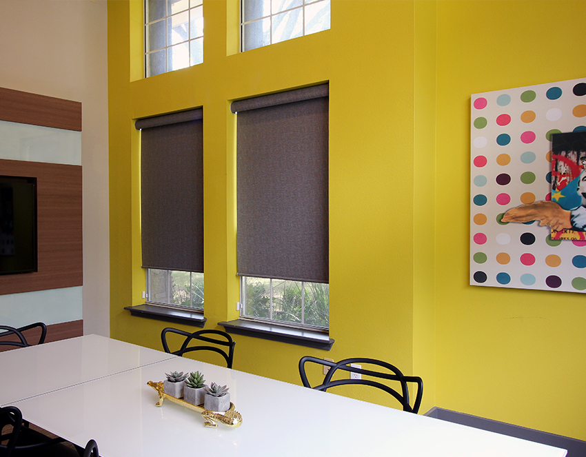 yellow conference room with hunter douglas roller shades Cedar Park 78613