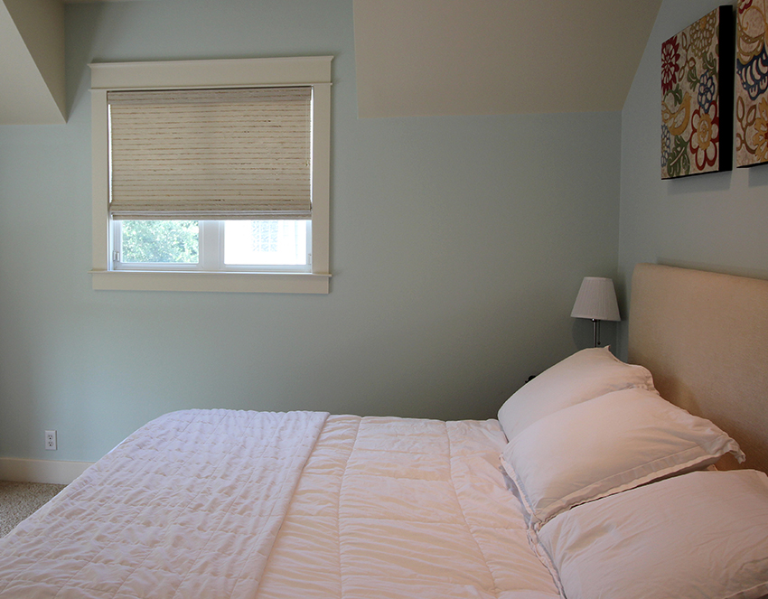 green bedroom with hunter douglas provenance woven shades Austin