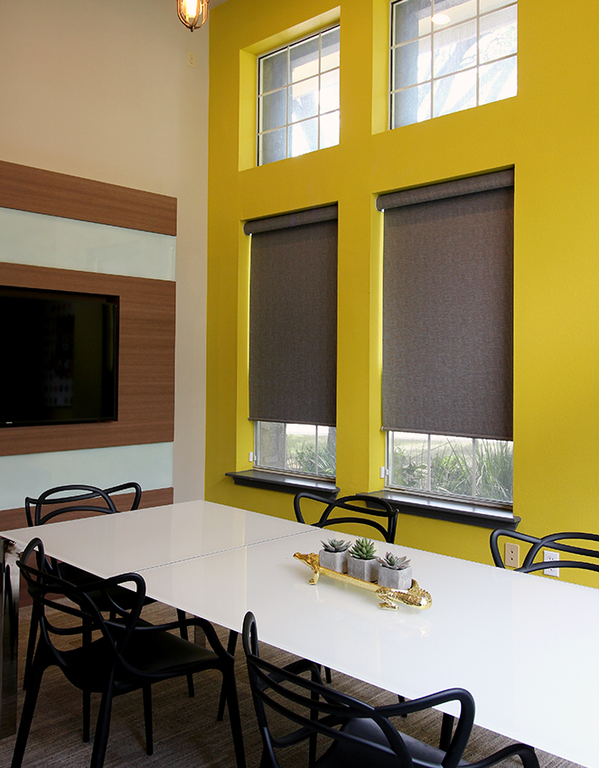 yellow conference room with brown hunter douglas roller woven shades Cedar Park 78613