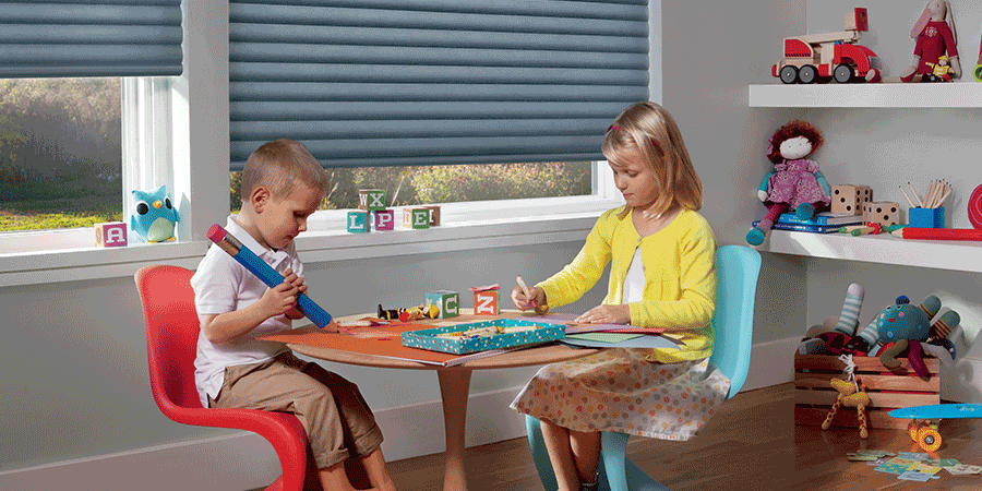 Children playing in Austin home in front of child safe blinds.