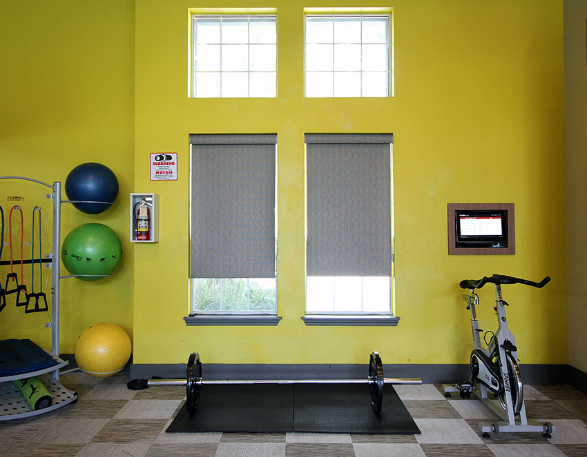 local gym Austin TX with gray roller shades