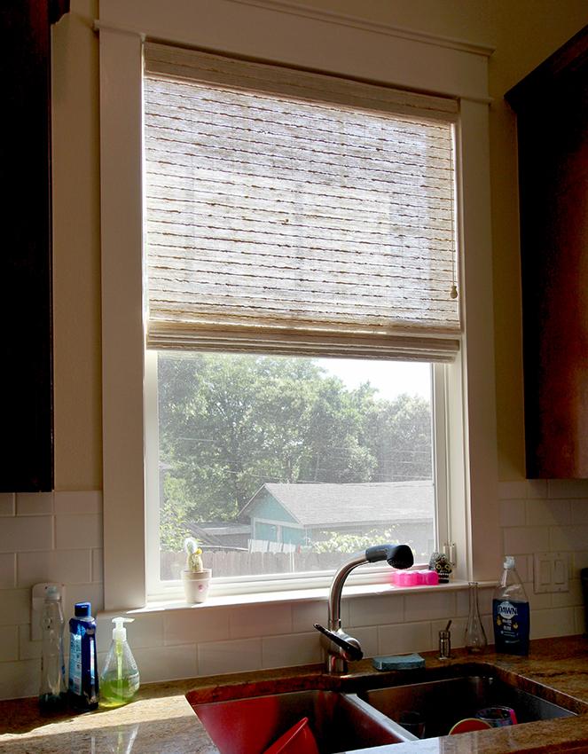woven wood roman shades above kitchen sink Austin TX