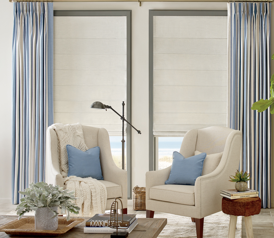 white fabric roman shades layered with blue white draperies Austin TX