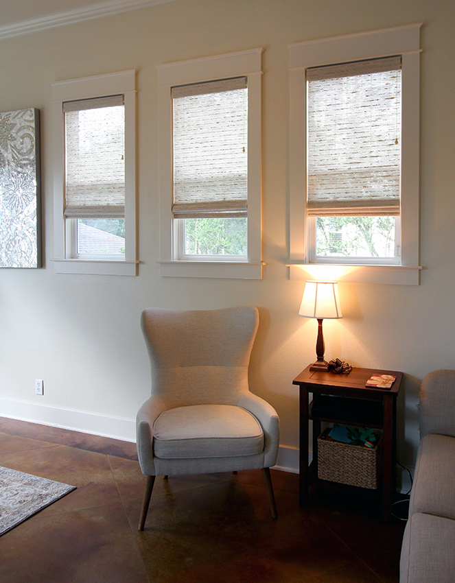 three windows with woven wood shades Austin TX