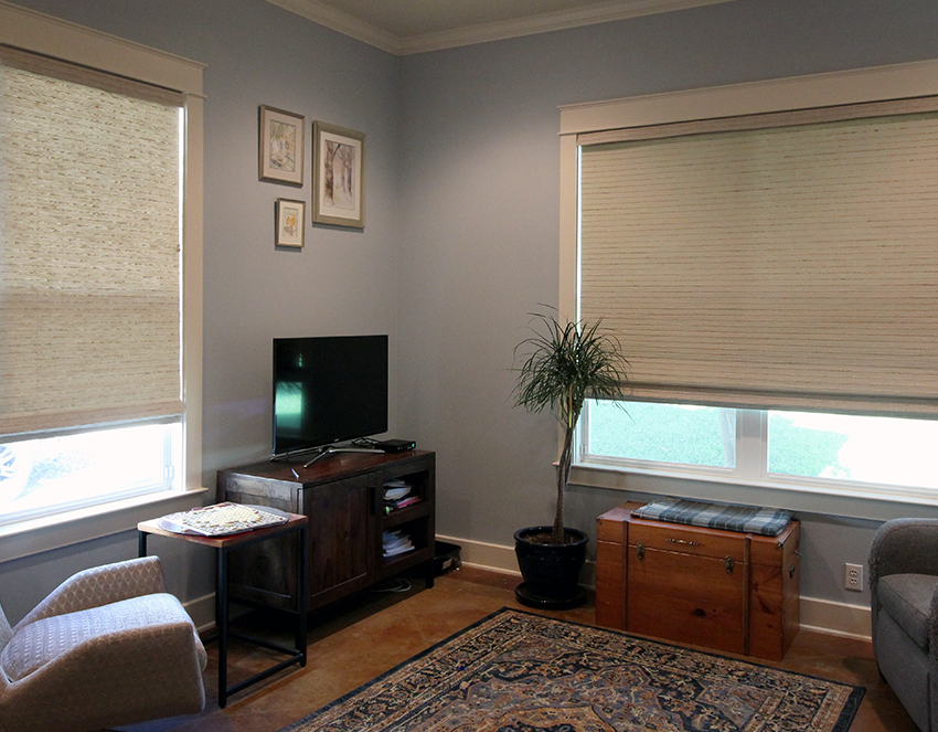 guest room with woven wood roman shades Austin TX