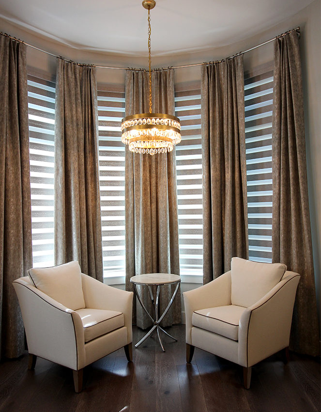 bay window with gold chandelier and layered custom window treatments Austin TX