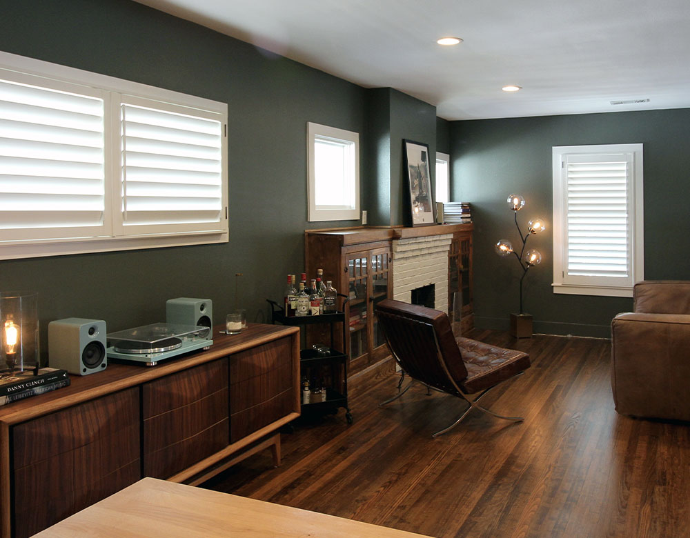 white shutters with green walls in Austin TX living room