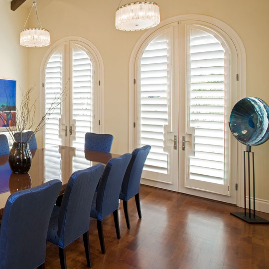 arched french door shutters in Austin TX dining room