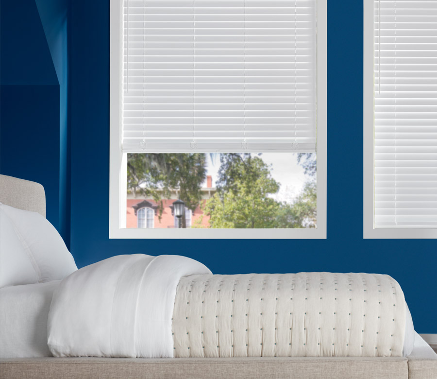 white faux wood blinds in teen bedroom in Austin TX