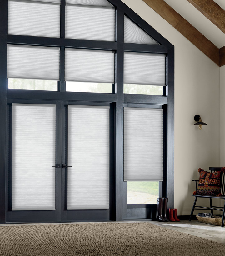 entryway with windows and doors covered with honeycomb shades in Austin TX