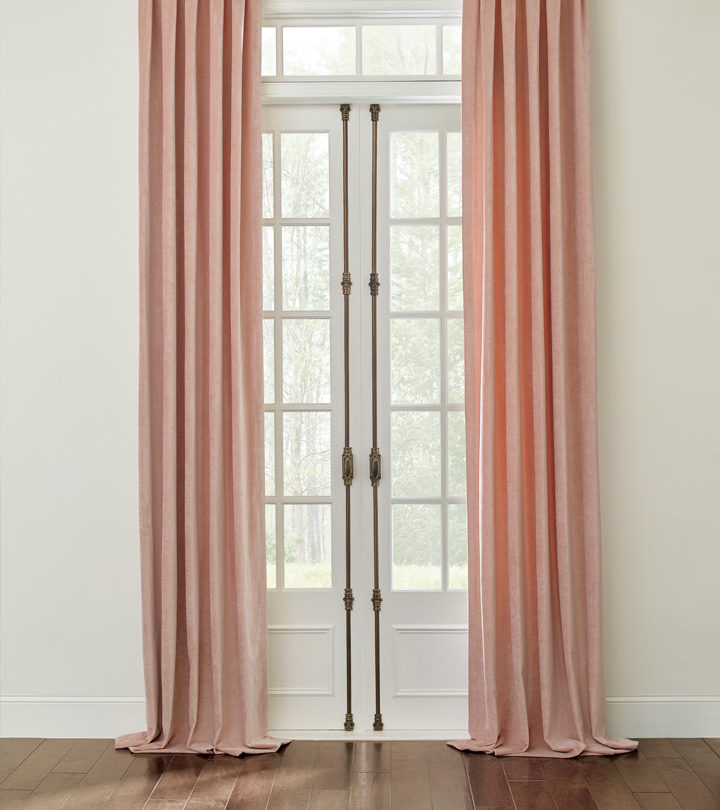 french doors with ceiling height draperies hung in Austin TX home