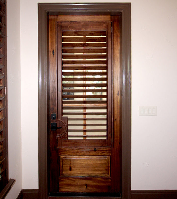 cover glass doors with knotty alder wood shutters in Austin TX
